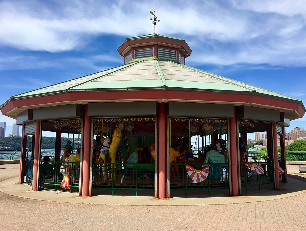 The summer schedule for the Totally Kid Carousel in Riverside Park includes weekday hours