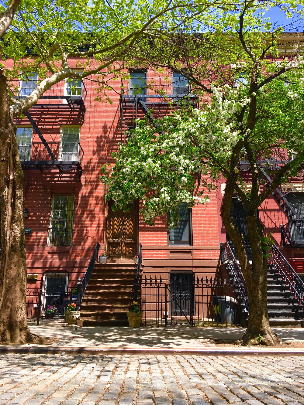 A cobblestone street in East Harlem's first historic district