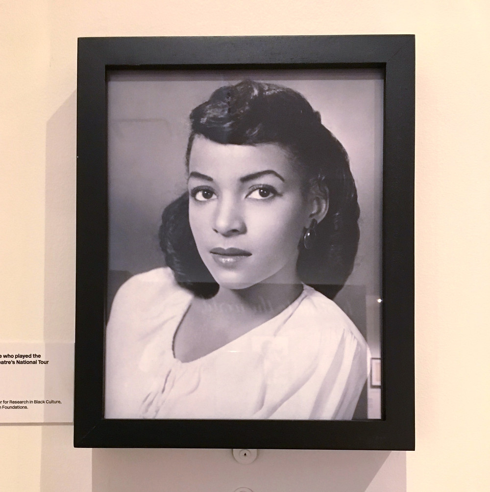 "A vintage photo of Ruby Dee at the ""Ballad for Harlem"" exhibit at the Schomburg Center"