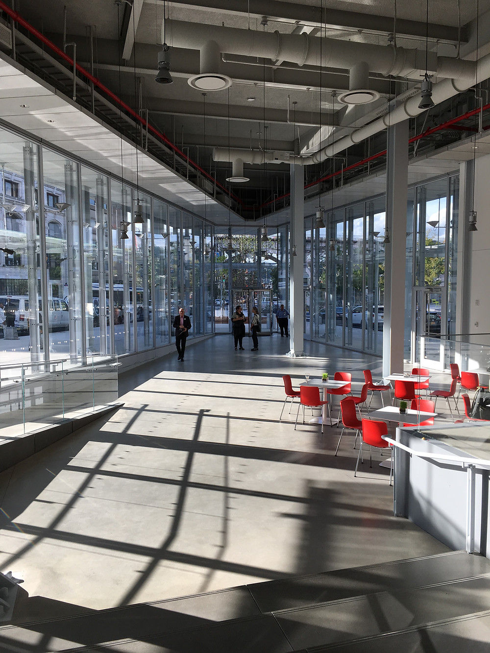 The ground floor of Renzo Piano's Forum is encased in glass