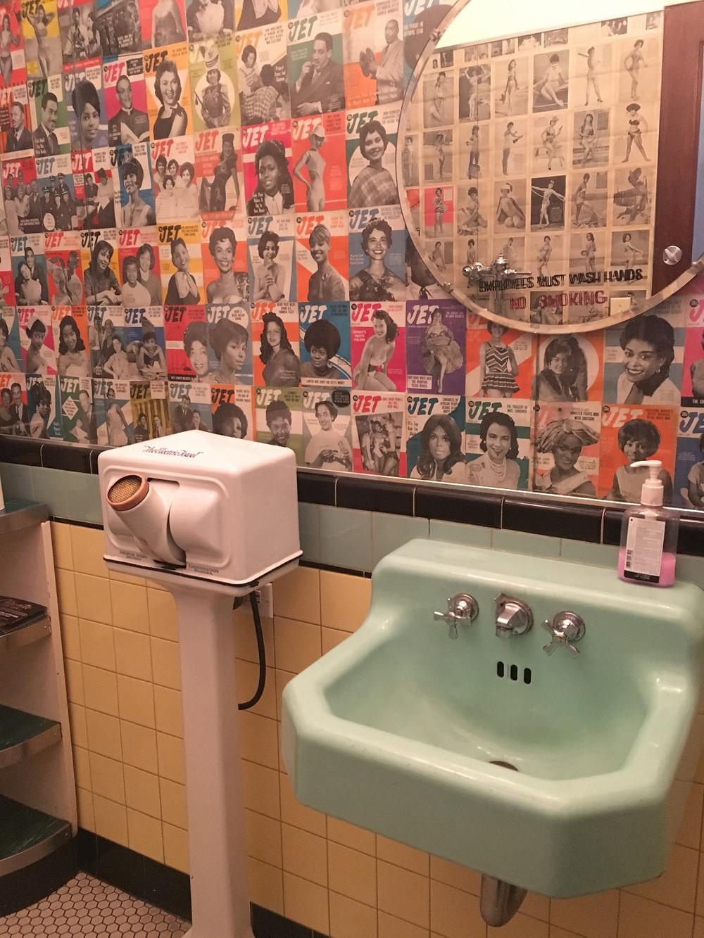 Harlem Shake bathroom with Jet magazine covers