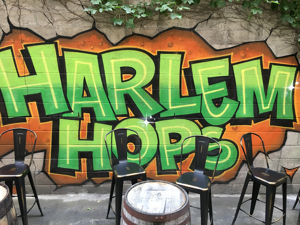 Enjoy craft beer in the backyard at Harlem Hops