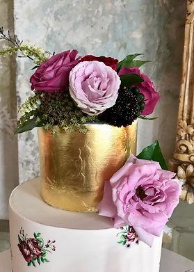 Wedding cake, gold leaf and fresh florals
