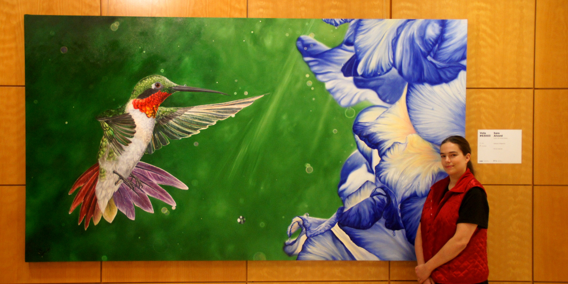 A 9' Oil Painting of a hummingbird with hyper realistic details