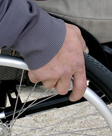 Close up of hand on wheelchair tyre