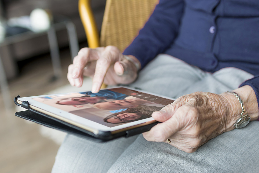 Long Term Care Resident Using An iPad to Facetime Family