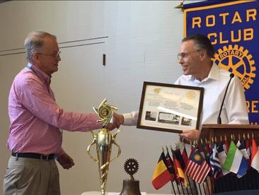 Gary Accepts An Award Rotary_edited.png