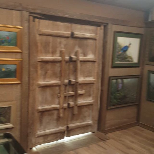 Antique chinese door from Asia America is the gallery's entrance