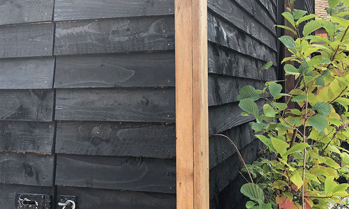 Black-Painted-Feather-Edge-Cladding