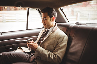 Man with sciatica seats comfortably on a cushion in a car