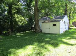 Rear view of house & shed.