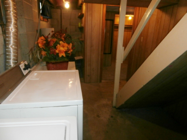 Clothes washer and dryer in basement.
