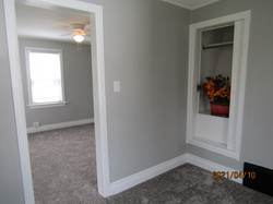 1st floor bedroom is light gray with white trim & new gray carpet; small closet.  No entry door.