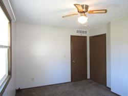 Deck-side bedroom view of closet and entry door.