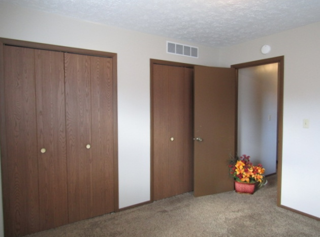 Carpeted south bedroom has dual closets.