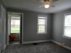 Front door entry has beige linoleum floor with closet on each side of entry foyer.