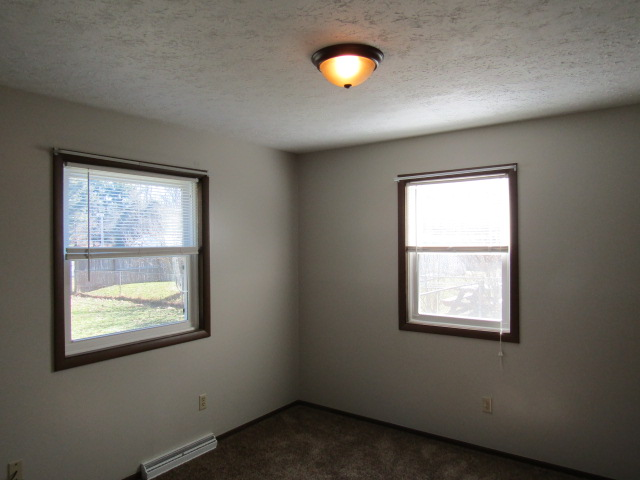 Another view of bedroom with two closets.