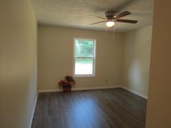 Rear bedroom, window, ceiling fan.