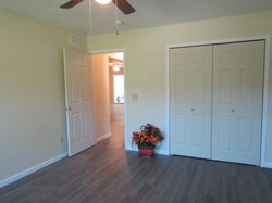 Front bedroom with 6' closet, ceiling fan