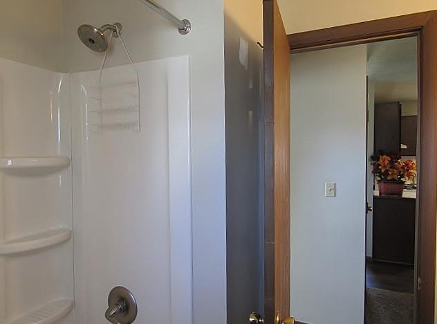 Bathroom view of bathtub/shower.