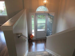 Front entry to conto has laminate flooring.