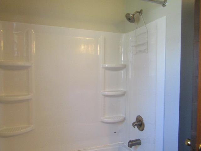 View of bathroom tub/surround.