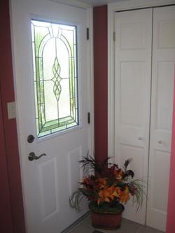 Lower level side door & closet
