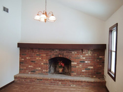 Living room has working fireplace.
