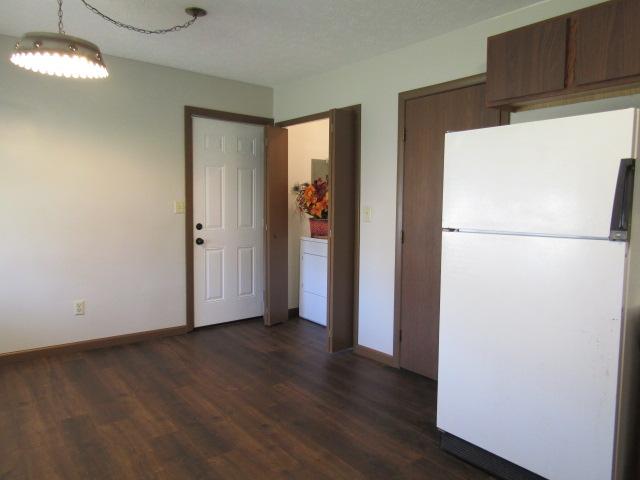 View of deck door and laundry closet.