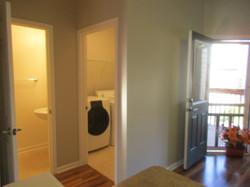Off kitchen is half bath & laundry with light colored vinyl floor; balcony.
