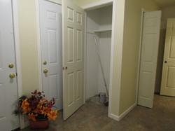 Foyer:  entry door, garage door, entry closet, laundry, basement door.