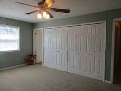 Master Bedroom with bank of closets and bath entry