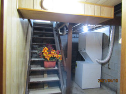 Stairs between kitchen & bath to basement and laundry area (apartment style washer & dryer).