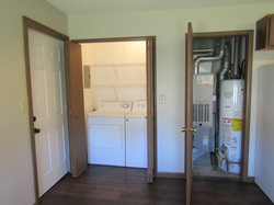 Laundry has washer & dryer; utility closets has hot water tank and year-old furnace.