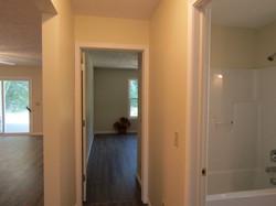 Hall, bath, rear bedroom, view of living room.