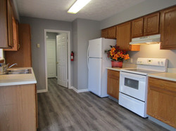 Kitchen door to laundry/utility room and garage