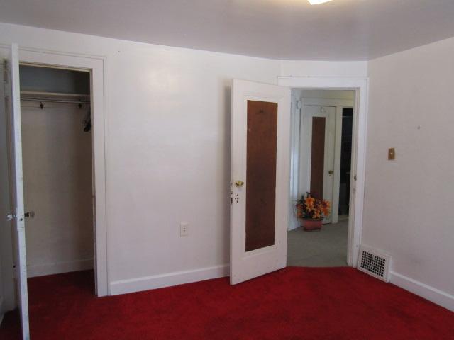 Bedroom view of hall linen closet