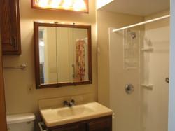 Bathroom with walk-in shower.