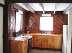 Basic kitchen has charm.
