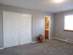 Primary bedroom closet and bath entry