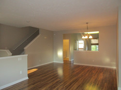 Open floor plan with living / dining room flowing into kitchen area.