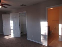 Doorways to walk-in closet and full bath.