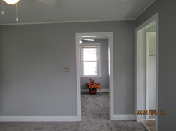 Entry to 1st floor bedroom to north of living room.