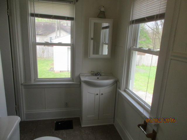 Full bath view of sink and windows.