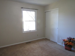Bedroom by stairs (closet view)