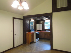 House entry, kitchen with basic stove & refrigerator