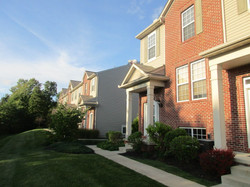 258 Woodhaven is a corner unit that faces a broad lawn and woods.