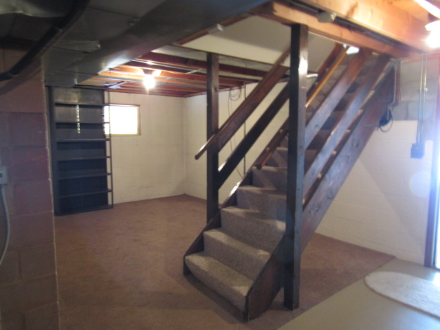 Stairs to lower level rec room