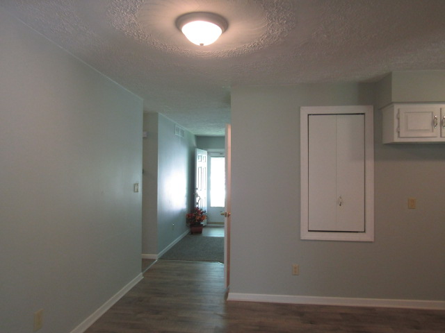 View of hall to front room from rec room