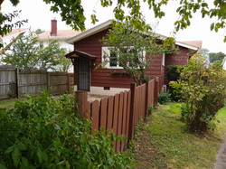Backyard partially fenced in.